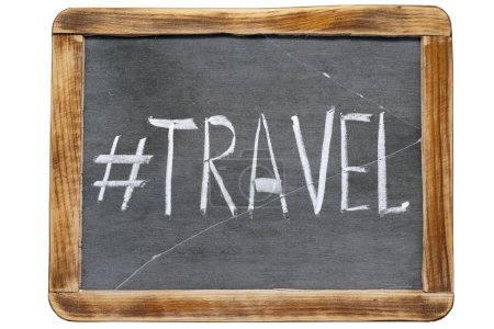 Photo for Travel hashtag handwritten on vintage school slate board isolated on white - Royalty Free Image