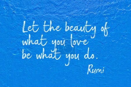Photo for Let the beauty of what you love be what you do - ancient Persian poet and philosopher Rumi quote handwritten on blue wall - Royalty Free Image