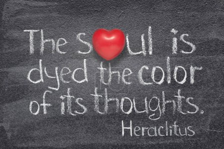 Photo for The soul is dyed the color of its thoughts - quote of ancient Greek philosopher Heraclitus written on chalkboard with red heart symbol instead of O - Royalty Free Image