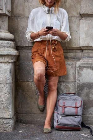Photo for Woman using phone in european city - Royalty Free Image
