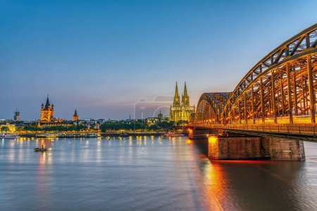 The river Rhine with the famous skyline of Cologne after sunset