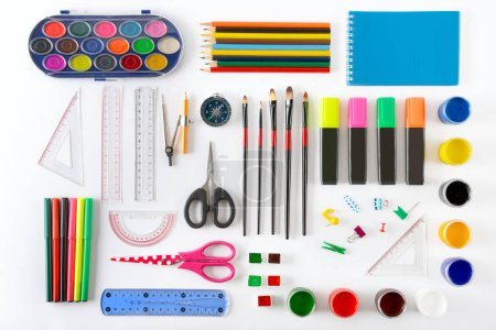 Photo for Set of school supplies on white background. Paint, pencils, notepad, brushes, scissors. Top view. - Royalty Free Image