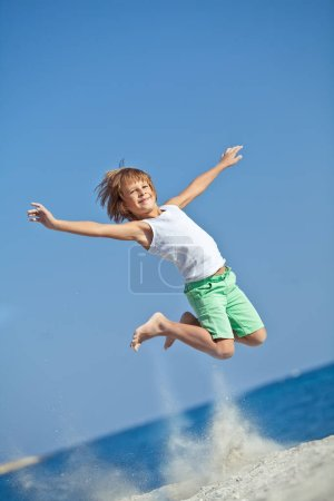 Photo for Child playing on ocean beach. Little boy running on tropical beach of exotic island during summer holiday. High quality photo. - Royalty Free Image