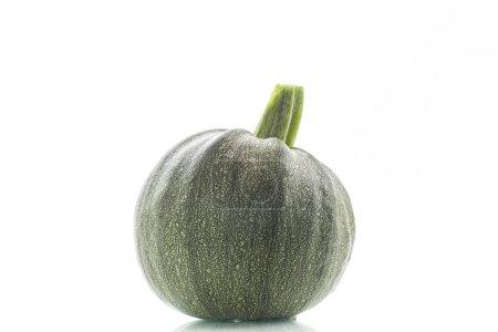 round zucchini on white background