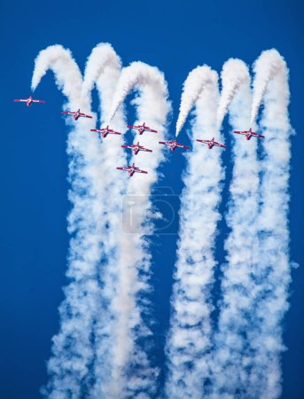 Royal Canadian Air Force Snowbirds demonstrating a...