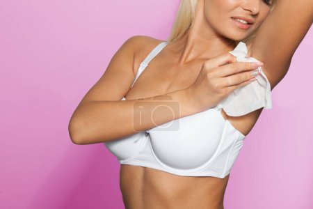 Photo for Woman wiping the armpit with wet wipes, perspiration, sweat - Royalty Free Image