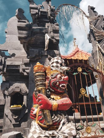 Sculpture of Barong, hinduism God, in front of balinese temple in Bali, Indonesia