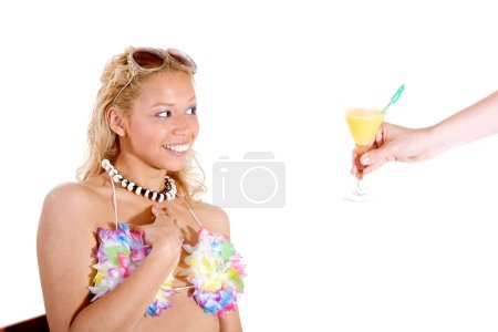 Photo for Pretty blond looking surprised at getting a drink offered to her - Royalty Free Image