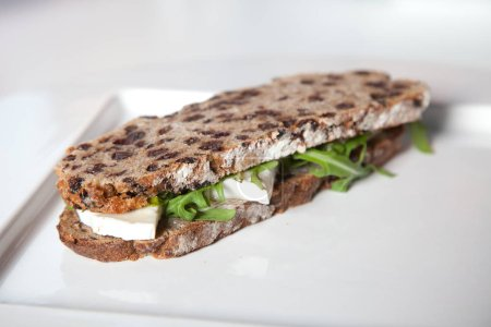 Photo for Healthy sandwich with goat cheese, honey and rocket salad - Royalty Free Image