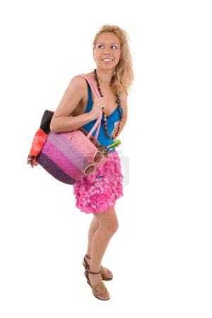 Photo for Pretty blond girl with beach bag going to the beach - Royalty Free Image