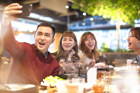 Photo for Young Group  taking selfie in the restaurant - Royalty Free Image