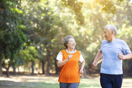 Photo for Happy Senior couple running in the park - Royalty Free Image