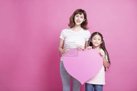 Photo for Happy mother's day! Mom and daughter showing love symbol - Royalty Free Image