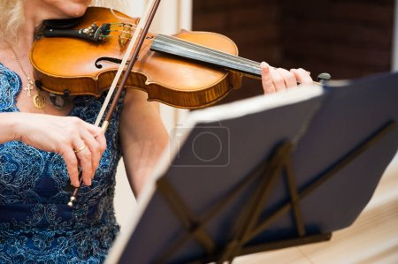Photo for Violin player hands. Violinist playing violin close up - Royalty Free Image