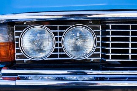 blue retro car headlights front