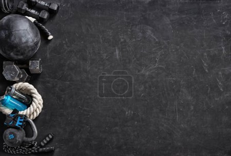 Photo for Sports equipment on a black background. Top view. Motivation. Copy space. - Royalty Free Image