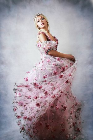 Photo for Beautiful princess in pink gown dress with lace and roses - Royalty Free Image