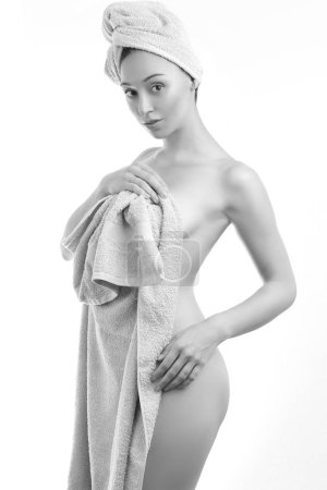 beautiful woman wrapped in towels after shower black and white - skin care concept freshness