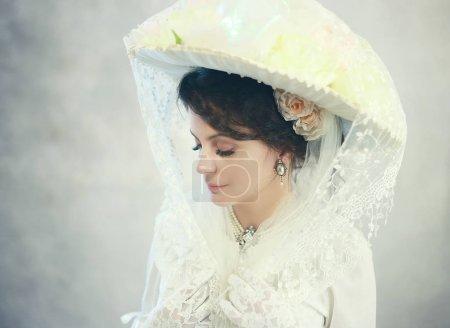 beautiful woman in big hat of victorian or edwardian era