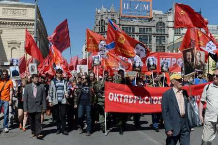 The column of the Communist Party with portraits of Joseph Stalin is in the center of Moscow at a demonstration.
