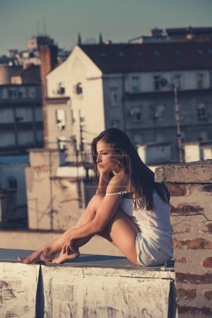 Photo for Pretty city girl enjoy in sunset at rooftop full body shot  late summer day - Royalty Free Image