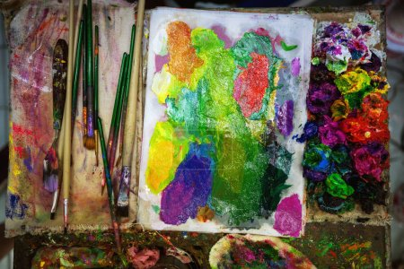 Photo for Artist paints oil palette - Royalty Free Image