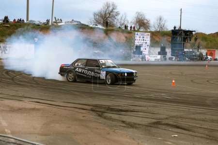 ODESSA, UKRAINE -23 April 2017: Combat drifters in local drifting competitions. Drifting show on an illegal platform. Riders professionally pass track in driftig qualification race at auto competitions