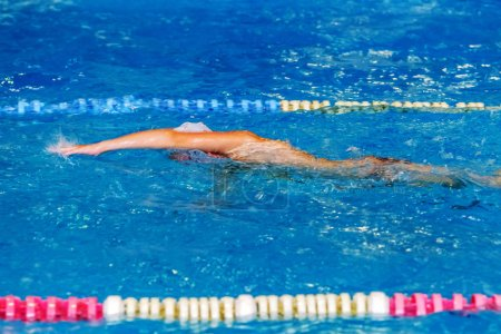 Photo for Sports background for splash topics - Sport swimming in the pool. Unsharp background on sports theme of a healthy lifestyle - swimming in the pool - Royalty Free Image