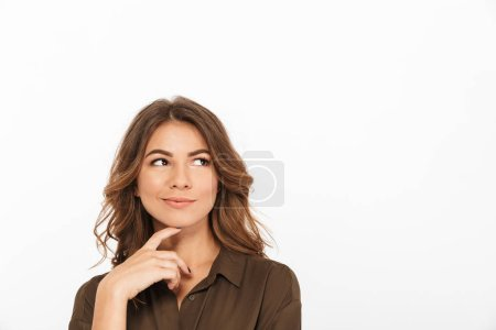 Photo for Portrait of a smiling young woman looking away at copy space isolated over white background - Royalty Free Image
