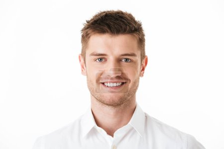 Close up portrait of a smiling young man looking at camera isolated over white background