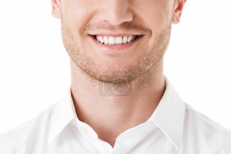 Close up of happy man's toothy smile isolated over white background