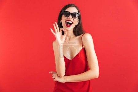Photo for Image of amazing emotional young beautiful woman posing isolated showing okay gesture. - Royalty Free Image