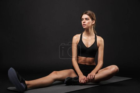 Attractive young healthy fitness woman wearing spo...