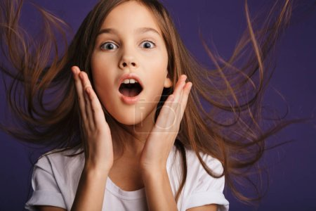 Photo for Photo of astonished beautiful girl expressing surprise on camera isolated over purple background - Royalty Free Image
