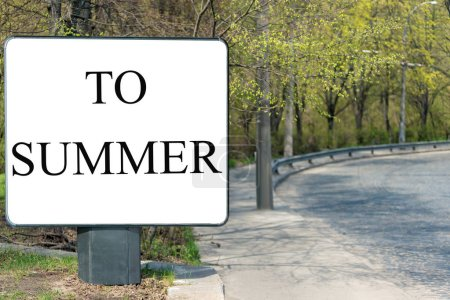 """Photo for Square billboard with an inscription on a white background """"TO SUMMER"""", stands on the side of the road from the briquette. Horizontal frame - Royalty Free Image"""