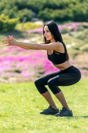Slender beautiful girl with dark hair in a sports ...