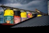 VANCOUVER, CANADA - June 14 : 'Giants' Public Art painted on Concrete Silos by Brazilian Artists on 14 June 2018 in Granville Island, Vancouver, BC, British Columbia, Canada