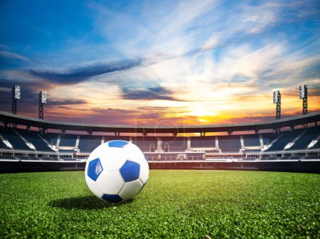 Soccer ball on the big football stadium over sunset as world cub championship concept background, mixed media