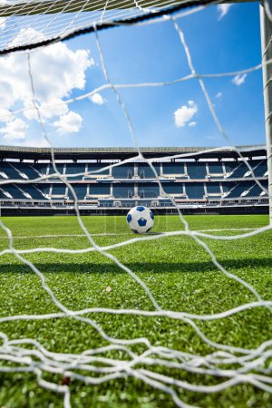 Football soccer stadium and ball behind gates net on the field - mixed media