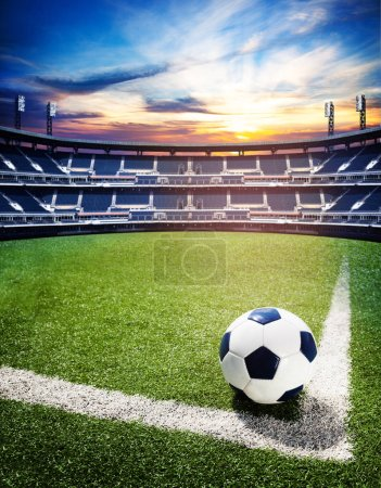 Concept of soccer world cup or national championship stadium background with football ball on the big field