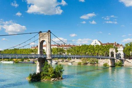 Gateway College walking bridge over the Rhone river in Lyon, France