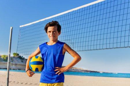 Portrait of teenage boy beach
