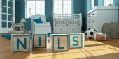 The name nils written with wooden toy cubes in childrens room