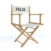 Felix written on director chair on isolated white background