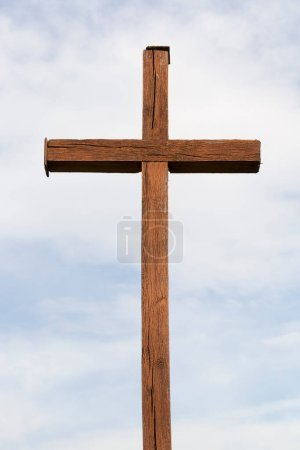 Photo for Old religious cross of wood against the blue sky. Photo close-up. Religious symbols of Christianity - Royalty Free Image
