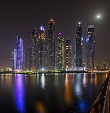 Dubai marina skyscrapers panorama during night hours