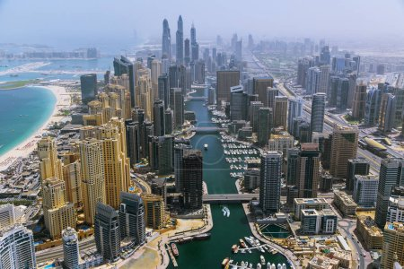 Aerial view of modern skyscrapers and sea in the background, Dubai, UAE.