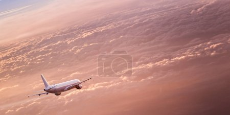 Commercial airplane flying above dramatic clouds.