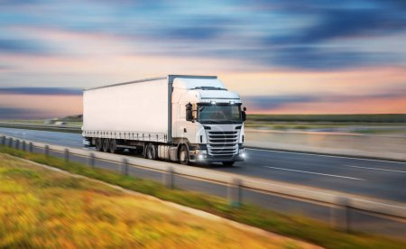Photo for Truck with container on highway, cargo transportation concept. - Royalty Free Image
