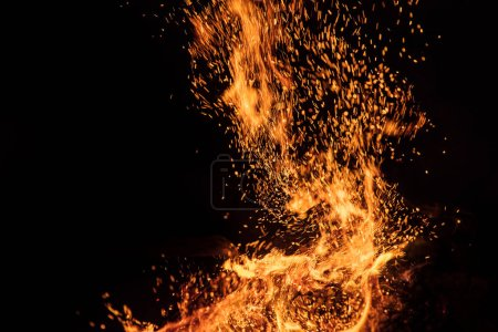 Burning sparks flying. Beautiful flames background.
